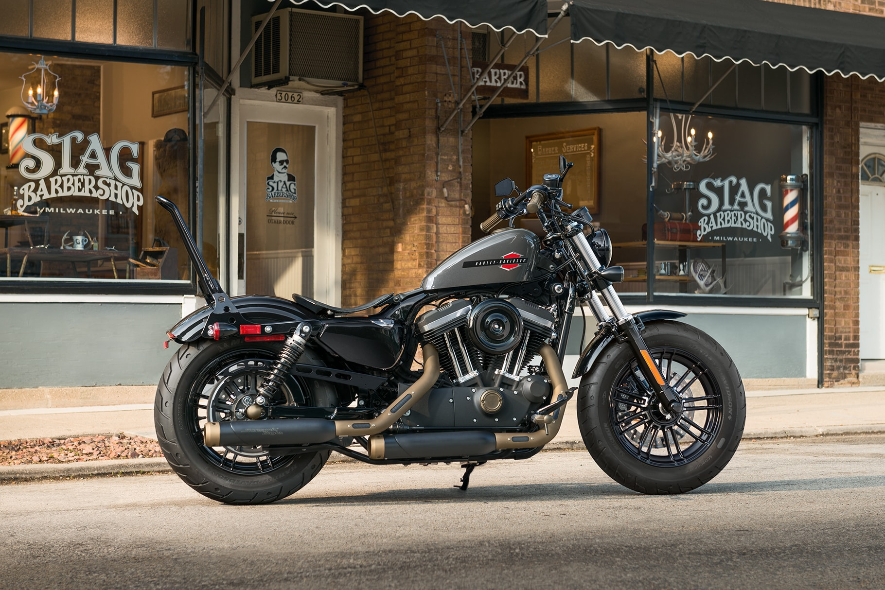 2019 H-D Sportster motorcycle Parked in Front of Stag Barber Shop