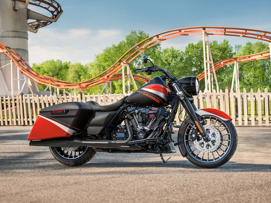 2019 Touring H-D Motorcycle Parked In Front of a Roller Coaster
