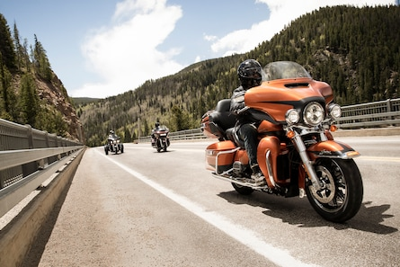 Men Riding 2019 Touring Harley Davidson Motorcycles on A Highway